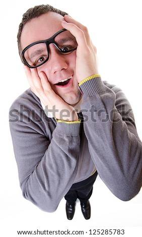 Computer Geek touches her face with white background - stock photo