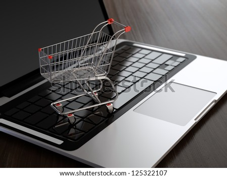 Computer generated image of shopping cart on laptop. E-commerce concept. - stock photo