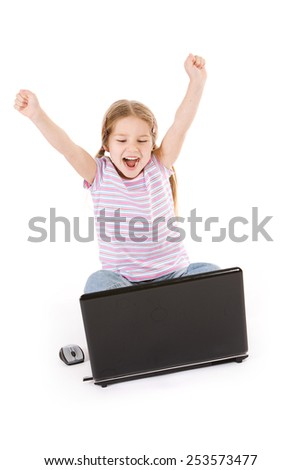 Computer: Girl Excited And Cheering While Using Laptop - stock photo
