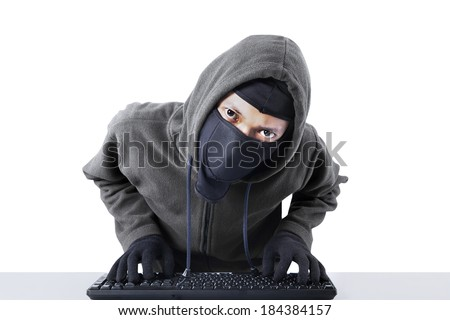 Computer hacker - Male thief stealing data from computer. isolated on white background - stock photo