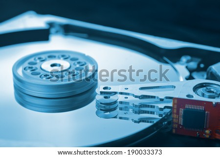 Computer hard disk close up detail with selective focus and shallow depth of field. Computer hardware, data storage and protection concept. - stock photo