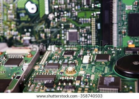 Computer Hard Disk Electronics Circuit, Macro Photo. Hard disk repairing concept, Data saving concept. Blur background with selective focus. - stock photo