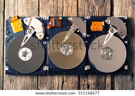 Computer hard drive on wooden background - stock photo