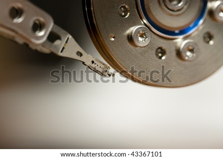 Computer hard drive without protective cover, 1 platter and 2 heads - stock photo