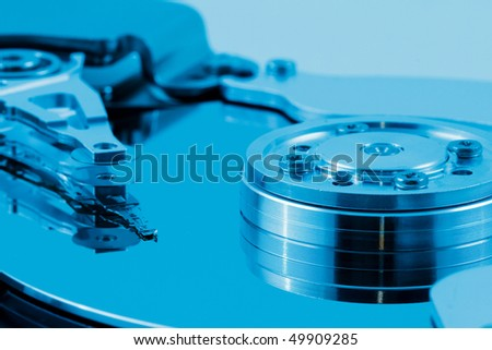 Computer harddiskdreive in blue light - stock photo