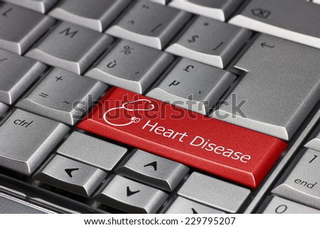 Computer key - Heart disease with stethoscope - stock photo