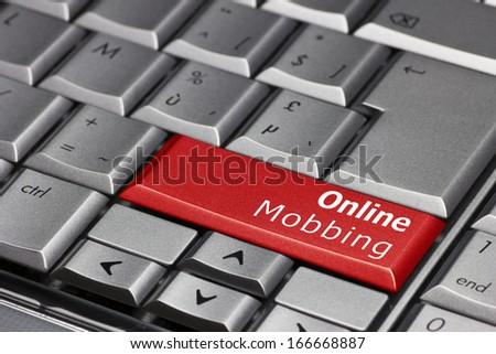 Computer Key - Online Mobbing - stock photo