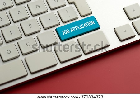 Computer key showing the word JOB APPLICATION - stock photo