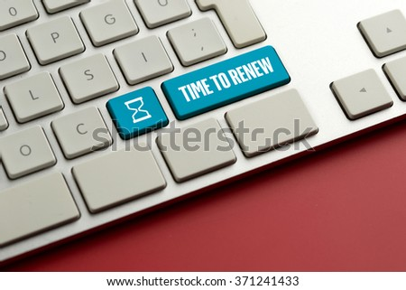 Computer key showing the word TIME TO RENEW - stock photo