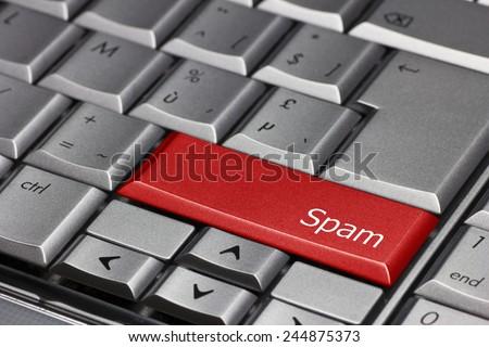 Computer key - Spam - stock photo