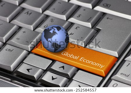 Computer key with globe showing the Americas - Global Economy - stock photo