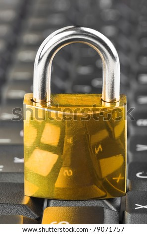 Computer keyboard and lock - technology security concept - stock photo