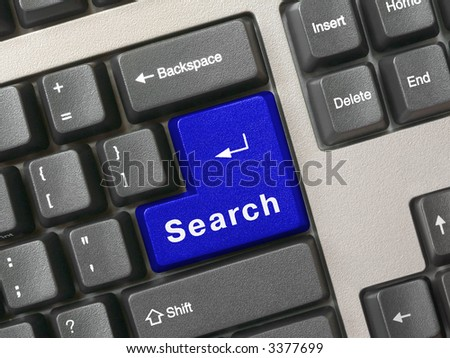 Computer keyboard - blue key Search, close-up - stock photo