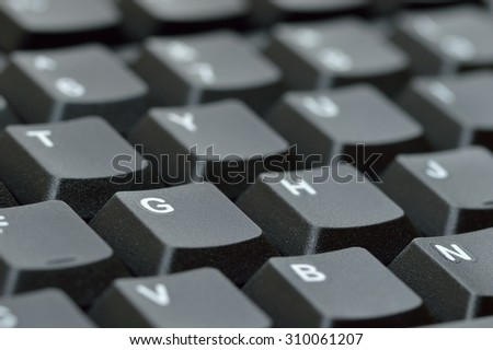 Computer keyboard. Close up of keys with shallow depth of field. - stock photo