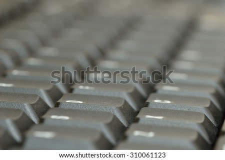 Computer keyboard. Close up of mostly blurred bands of keys on an acute angle. - stock photo