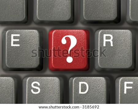Computer keyboard (close-up) with red question key - stock photo