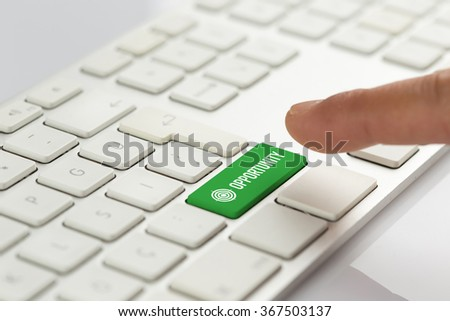 Computer Keyboard Concept: Hand pushing green OPPORTUNITY keyboard button - stock photo
