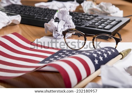 computer keyboard, glasses, American flag - stock photo