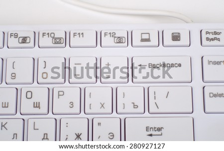 Computer keyboard on isolated white background, top view - stock photo