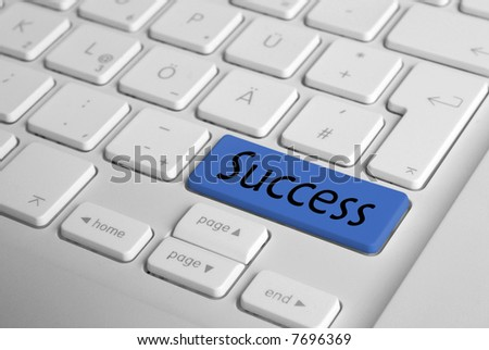 "Computer Keyboard with big ""Succes"" button. Shallow deep of field. Focus only on the blue button. - stock photo"