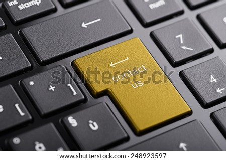 """Computer keyboard with """"contact us"""" button, selected focus on enter button - stock photo"""