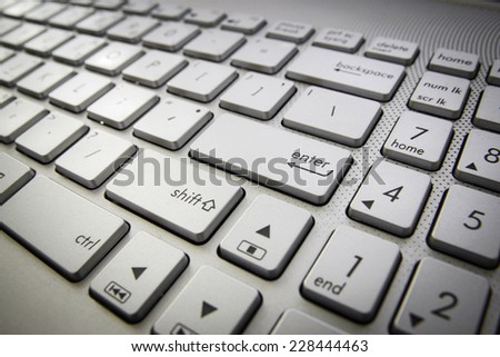 computer keyboard with enter button - stock photo