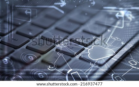 Computer keyboard with glowing cloud computing and multimedia icons - stock photo