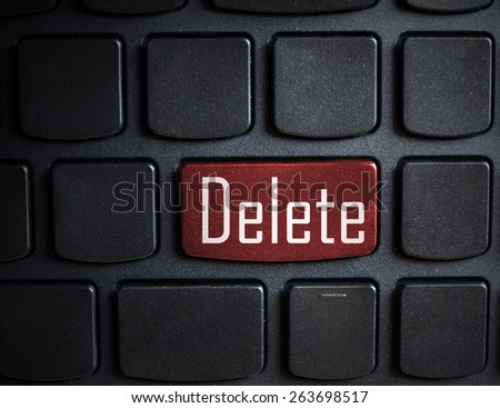 Computer keyboard with red key delete - stock photo