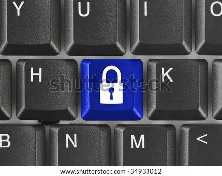 Computer keyboard with security key - technology concept - stock photo