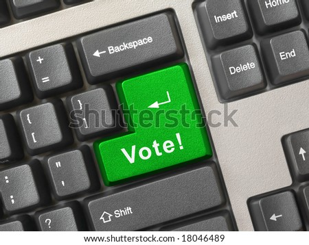 Computer keyboard with vote key, business concept - stock photo