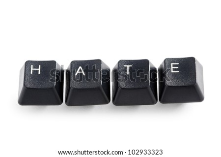 computer keys isolated on white spelling the word  hate - stock photo