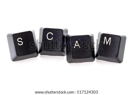 computer keys spelling the word scam concept - stock photo