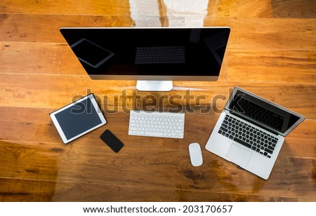 Computer ,laptop , tablet , smart phone on wood table - stock photo