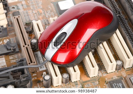 Computer mainboard and mouse - stock photo