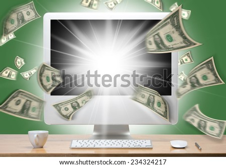 computer monitor and dollars. Money taking off from the screen  - stock photo