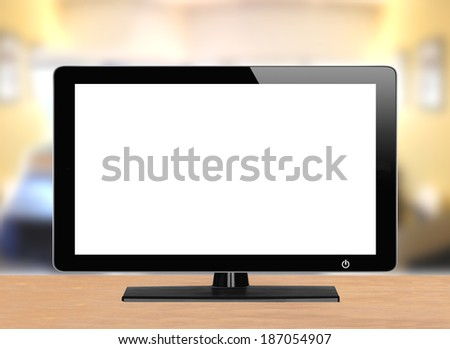 computer monitor on wooden table over bright background - stock photo