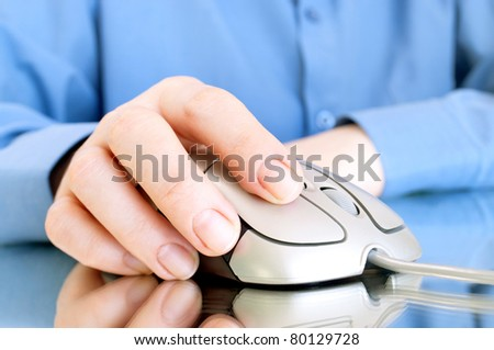 Computer mouse and hand with reflection - stock photo