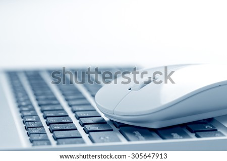 computer mouse near keyboard - stock photo