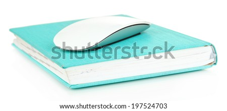 Computer mouse on book isolated on white - stock photo