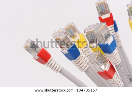 computer network cables over grey background  - stock photo