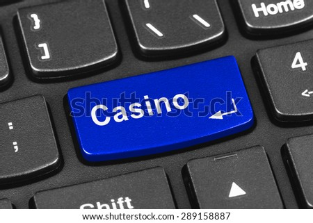 Computer notebook keyboard with Casino key - technology background - stock photo