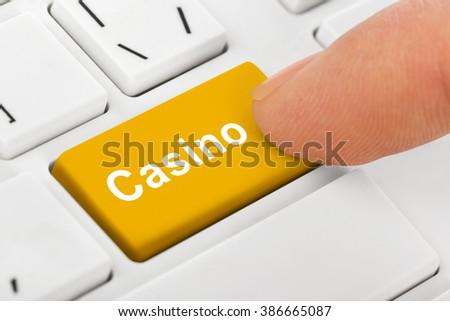 Computer notebook keyboard with Casino key - technology background - stock photo