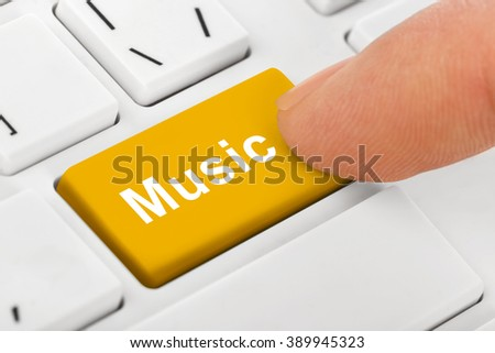 Computer notebook keyboard with Music key - technology background - stock photo