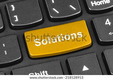 Computer notebook keyboard with Solutions key - technology background - stock photo