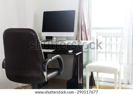 Computer on Home Office with phone - stock photo