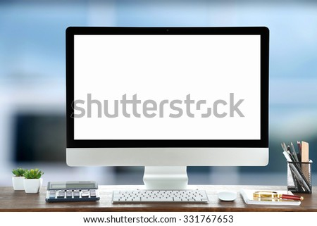 Computer on wooden table on abstract background - stock photo