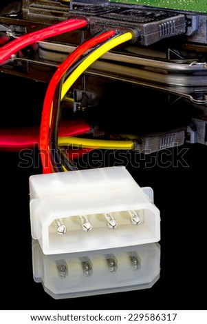 Computer plug and wires leading to hard drive - stock photo