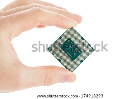 Computer's processor in hand isolated on a white background - stock photo