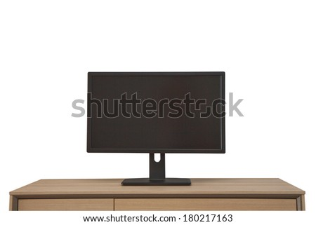 computer screen on wood table isolated on white background - stock photo