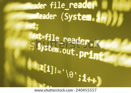 Computer script. Programming code abstract screen of software developer. Digital abstract bits data stream, cyber pattern digital background. Selective focus effect. Yellow orange color.  - stock photo